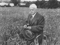 howard-sochurek-american-poet-robert-frost-standing-in-meadow-during-visit-to-the-gloucester-area-of-england